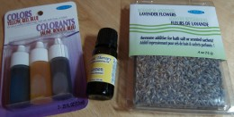 Colorants, essentail oil, and lavender flowers (a botanical additive) used by the author in the making of bath salts.