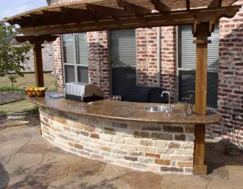 stone face, stained concrete counter, pergola over-head