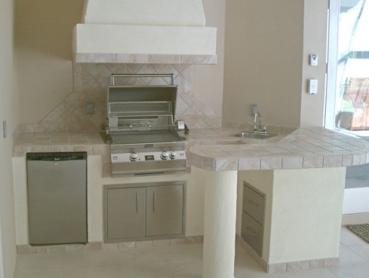tiled counter and backsplash . notice the hood vent