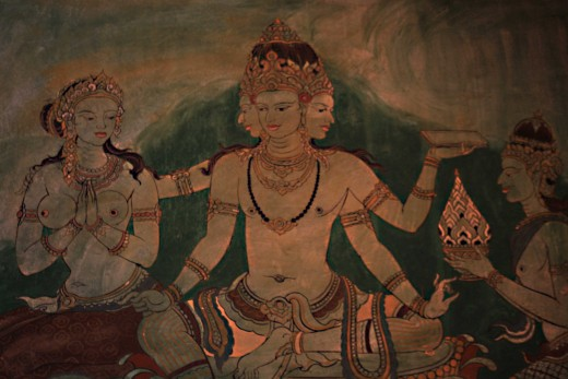 The four-faced God Brahma, sitting on a lotus blossom