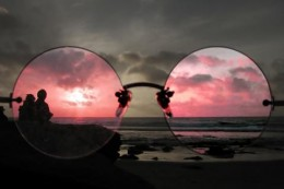 Seeing the world through rose colored glasses.