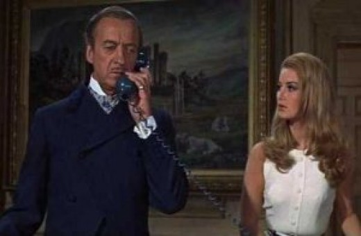 "The ""real"" James Bond (David Niven) and Miss Moneypenny (Barbara Bouchet) figure out their next move."