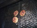 The last three burgers on the grill!