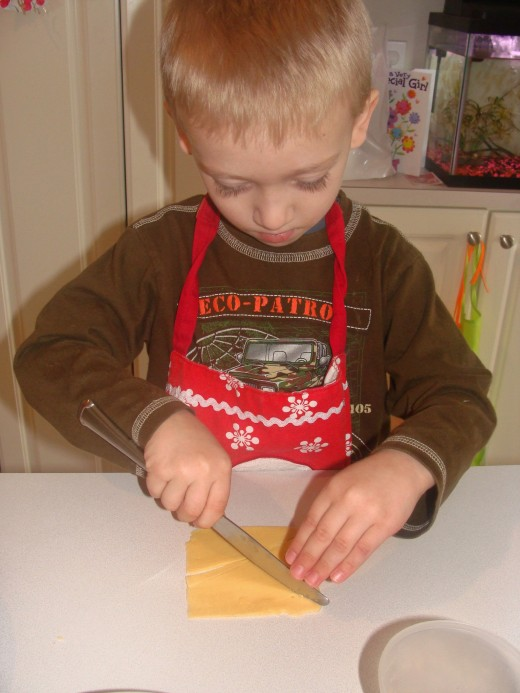 Alex demonstrates the ease at which even a young child can use a safety knife in the kitchen.