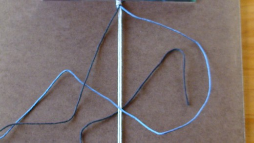 Step 5.1  Left cord (black) passes underneath anchor cords and right cord (blue).