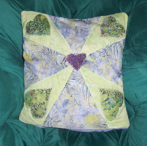 Finished quillow folded into a pillow The pieced pillow top is flipped to the  outside and you have a beautiful pillow.