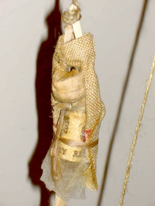 I put together a figure of a tortured man using a sack, straw, popsicle sticks, a cork, bubble wrap and twine.