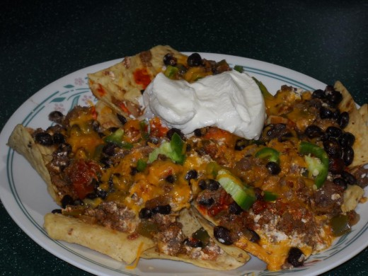 Top some chips with bean dip and sour cream, it's like instant nacho's.