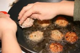 Frying the chicken meatballs.  The oil should be less
