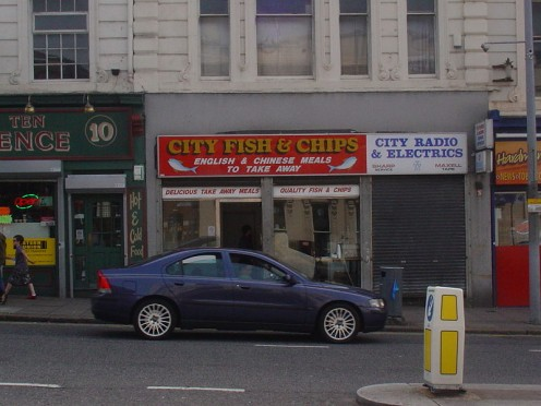 Take-out foods are available nearly everywhere in the world, making them very difficult to avoid. This fish and chips / Chinese take away shop is in Liverpool, England.