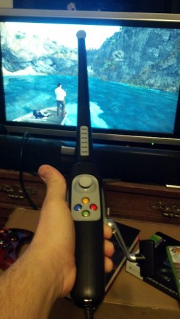 Me playing Bass Pro Shops: The Strike with the fishing rod that came with the game.