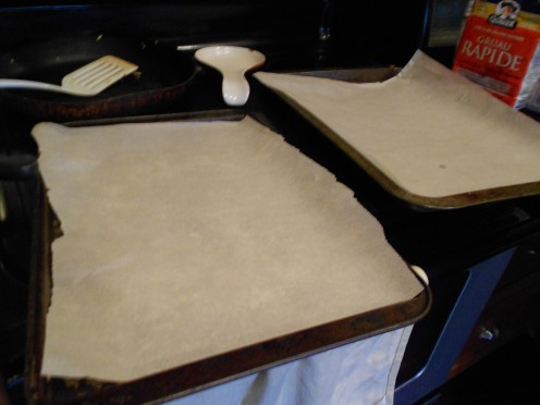 Line cookie sheets with parchment or lightly grease with butter