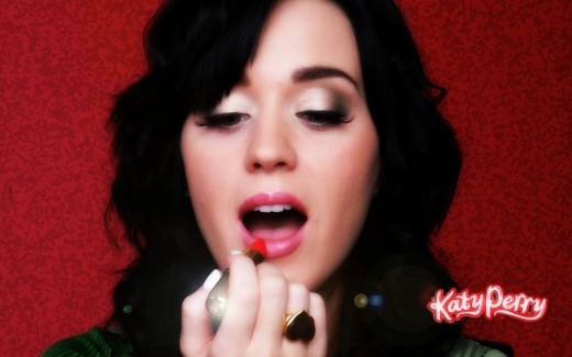 Katy Perry putting on lipstick