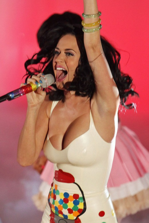 Katy Perry screaming with mic and some rather large breasts
