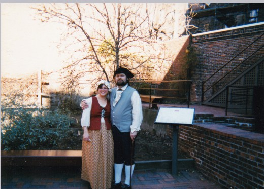 My husband and I dressed in Colonial costume during the Paul Revere House holiday program in December of  1998