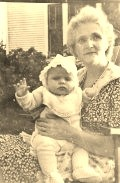 My paternal grandma holding me when I was a baby.
