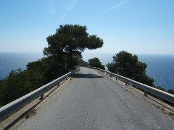 """At Grimaldi, in Italy, near the French border, this secondary road above the """"Corso Mentone"""" seems to plunge into the Mediterranean."""