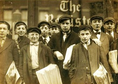 Newspaper boys in 1888 London.