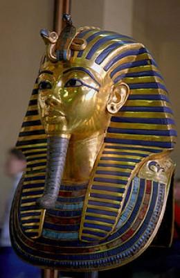 The Royal Cobra (Uraeus), representing the protector goddess Wadjet, atop the mask of Tutankhamun