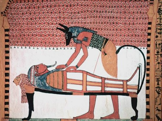 Anubis was the ancient Egyptian god associated with mummification and burial rituals. Here, he is shown attending to a mummy.