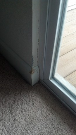 Cracks around LUXURY door, Has since been fixed, was caulked. not fixed, patched