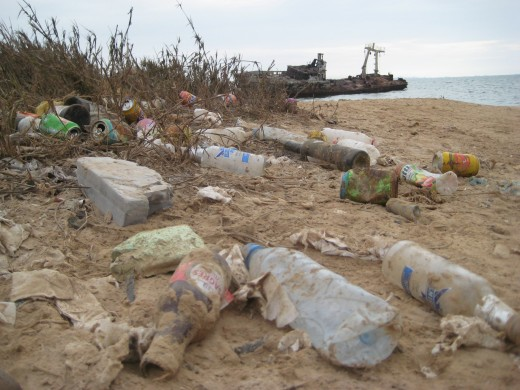 What happens to your plastic bottles, glass bottles and aluminum cans when you're done with them? Recycle them so they don't end up like this!  I took this photo outside of Luanda, Angola.