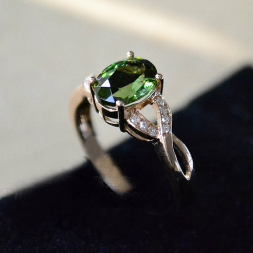 A lovely handmade green tourmaline engagement ring