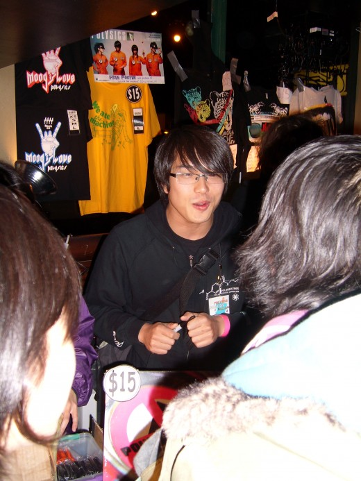 Hiro signing some autographs and talking to some excited fans.