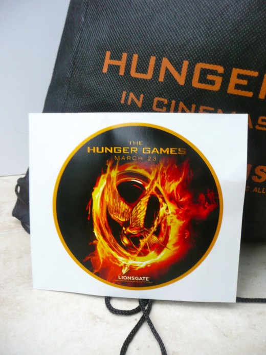 Hunger Games merchandise is commanding high prices on E-bay, but some newspapers are giving it away free.