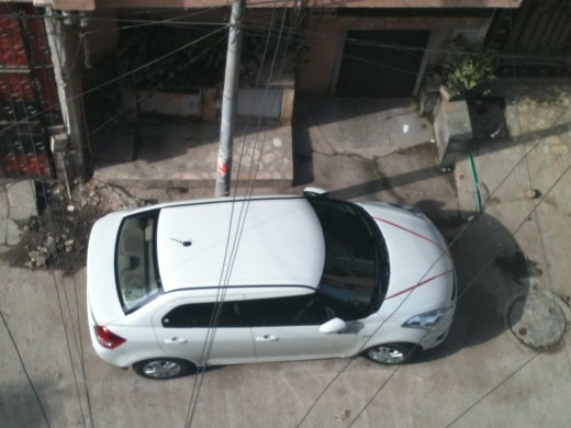 New Dzire - White is forever. Photograph taken at the back of my house.