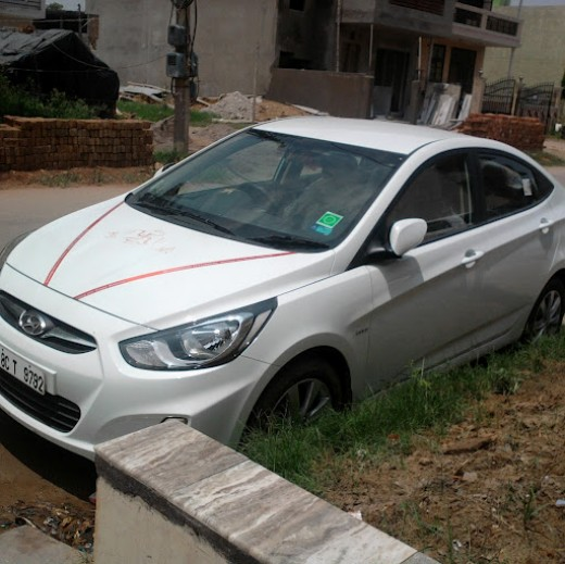 Hyundai Fluidic Verna white color. Picture taken in Indirapuram, Ghaziabad