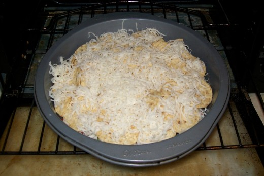 Top it all off with more shredded cheese and pop in the oven.