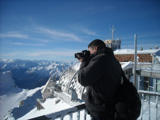 Darryl at the top of the Alps working on the perfect photo