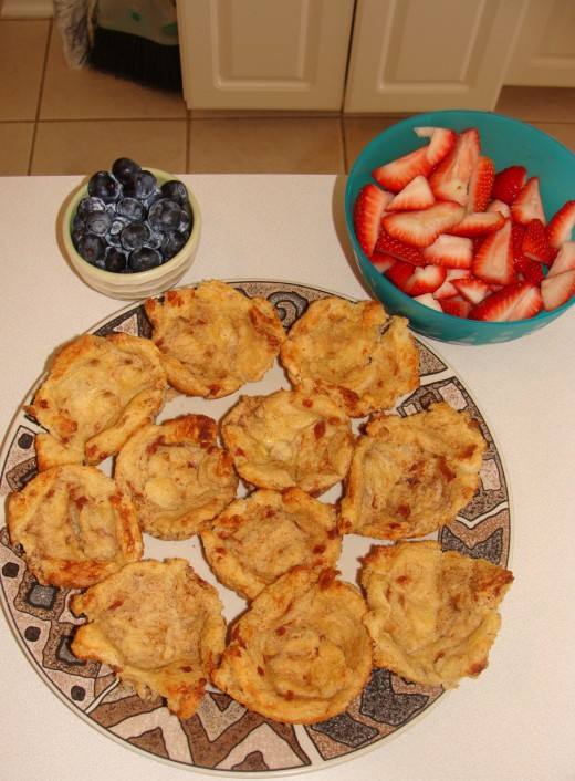Place the French toast and fruit on plates or in bowls to make filling them easy for the kids.