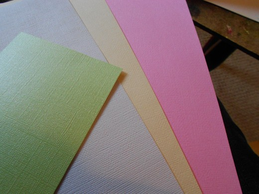 Lay out some colours of paper that reflect the person the card is for