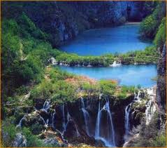 The river flows to the lake, leading to the  waterfall, downward in effortless motion, as it has been doing for centuries