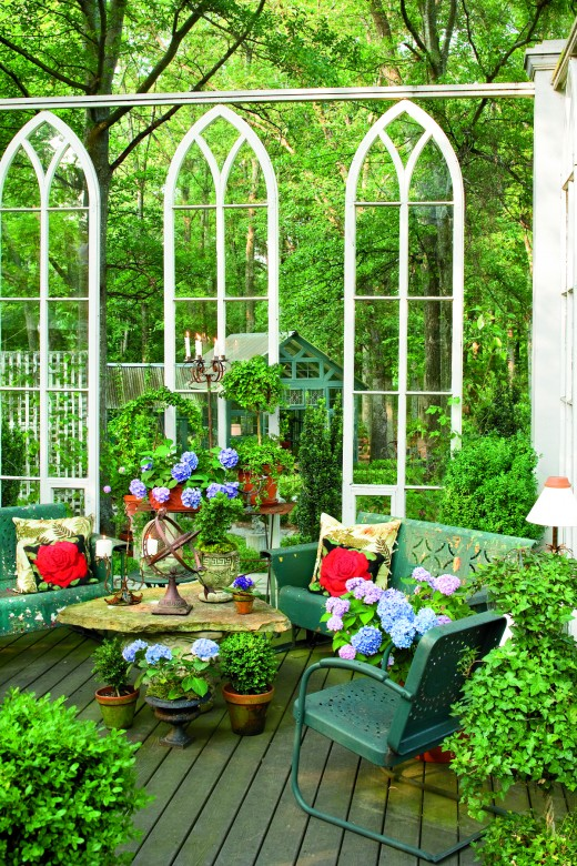 Beautiful outdoor space created by vintage metal porch gliders,metal lawn chairs......