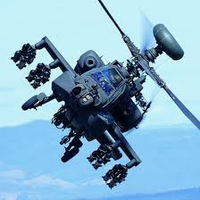 Military helicopter carrying advanced weaponry.