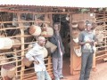 Workers Outside the Drum Shop in Mpambire