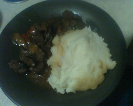Broiled marinated steak tips with mashed potatoes