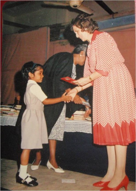 Collecting my first prize at school