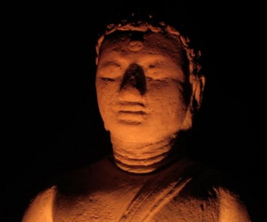 A Buddhist statue representing a meditating Buddha.