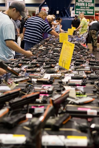 Wares and weapons on display at a Houston Gun Show.  (Photo credit and thanks to Michael Glasgow under Creative Commons)
