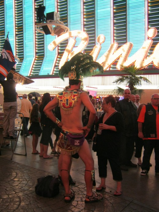 "Oh my goodness, well, in the background is the casino ""Binion's"" where you can go to have your picture taken with a million dollars on Fremont street."