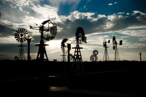 Energy Production. Windmills at Sunset