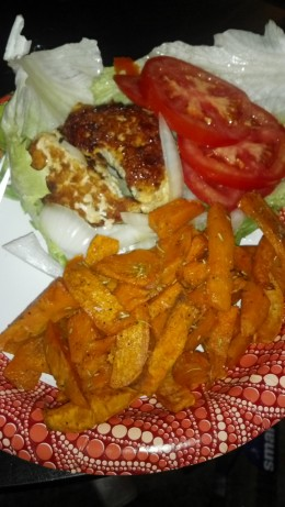 Chicken Burger on a bed of lettuce, Sweet Potato Fries.