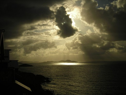 Rays of hope amidst storm clouds. Photo taken from Saint John Island's southernmost tip. The end of the world may come, but hope remains.