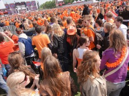 Nearly every person on Earth has an ego which is too often easily bruised. A crowd of people celebrating Queensday in Amsterdam by wearing orange.