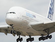 Airbus 380 landing with multi bogey L.Gs extended.