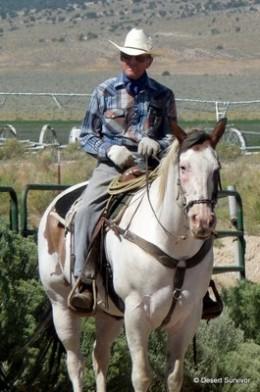"""Older Cowboy carefully watching some """"Roping"""""""